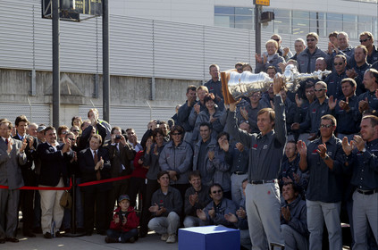 03_2215D ©Th.Martinez Team .Geneva , Switzerland. America's Cup 2003. 8th March 2003.Alinghi Team winner of America's Cup 2003, arriving in Geneva Airport with the America's Cup..Ernesto Bertraelli (Alinghi's president and navigator) holding up the Cup to media during welcome cermony at Geneva Airport with all Alinghi team behind him....